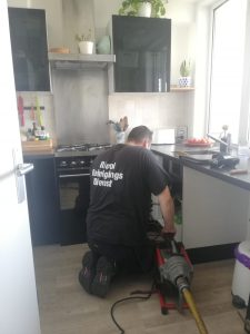 unclogging a drain in Amsterdam with professional equipment